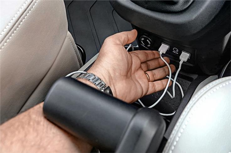 Front USB ports not easy to access. Handbrake lever fouls with hand.