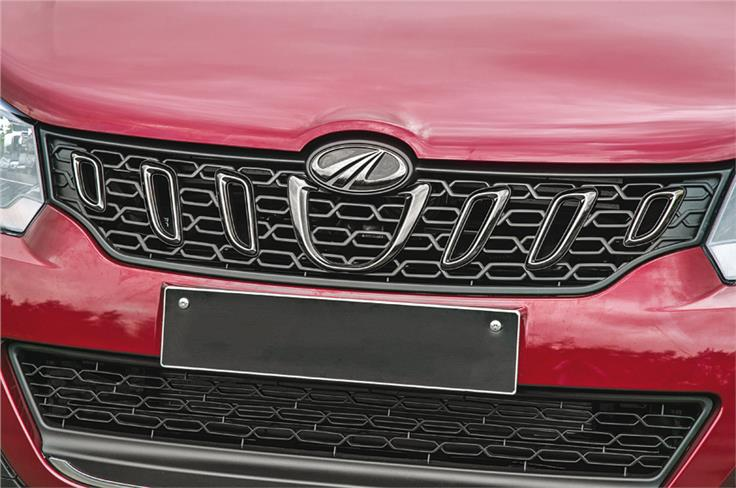 The toothy grille is a Mahindra-typical design element.