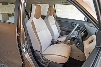 The Wagon R's flat front seats get fixed headrests.