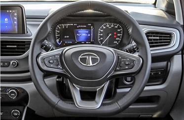 Leather-wrapped and flat-bottomed steering great to hold.