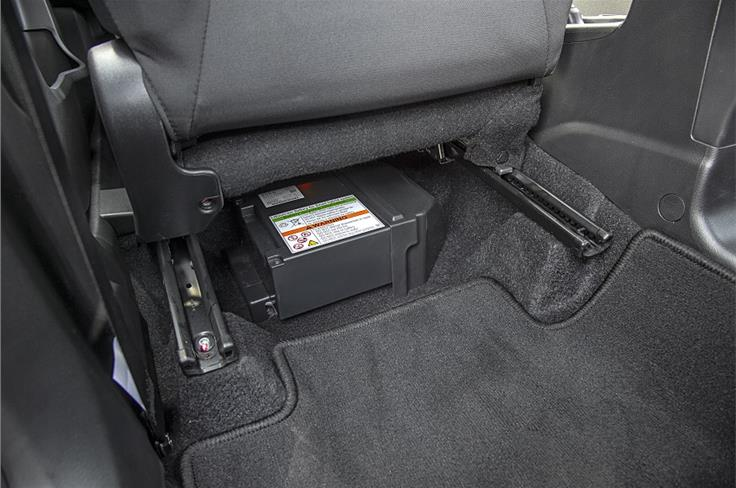 Lithium-ion battery under front passenger seat eats into foot room.