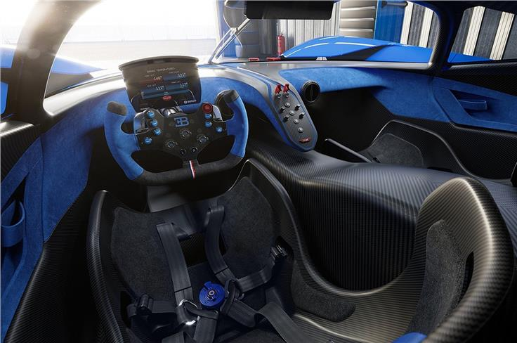 The interior is driver-centric, with a single screen in the cabin - the digital instrument cluster.
