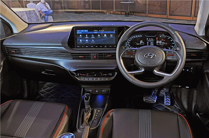 The dashboard is dominated by the free-standing 10.25-inch touchscreen infotainment system.