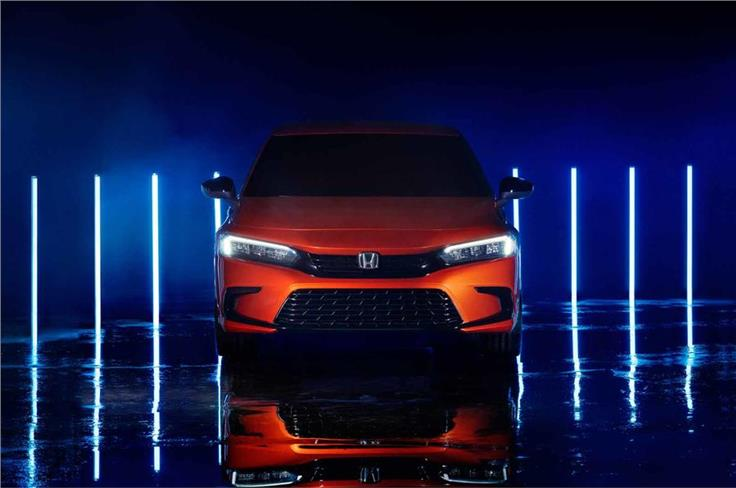 The new Civic has a reworked, smaller grille at the front.