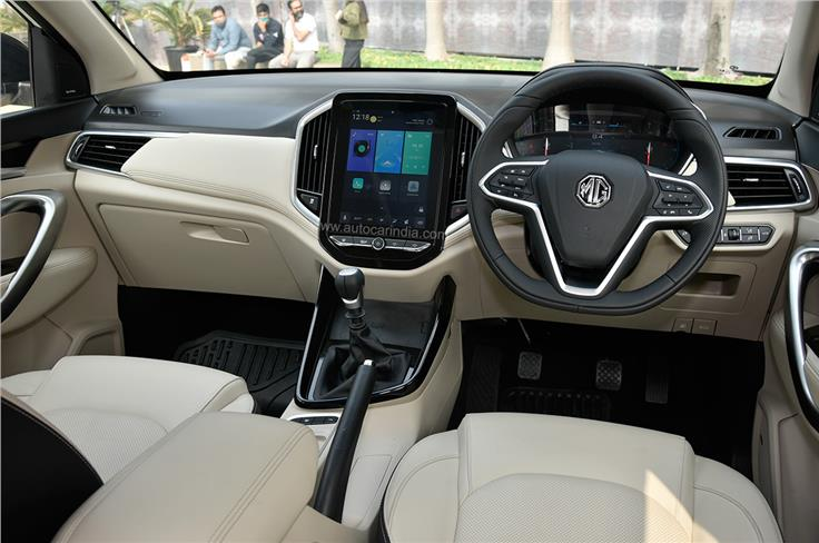 The dashboard layout remains unchanged, with the 10.4-inch portrait-oriented touchscreen taking centre stage.