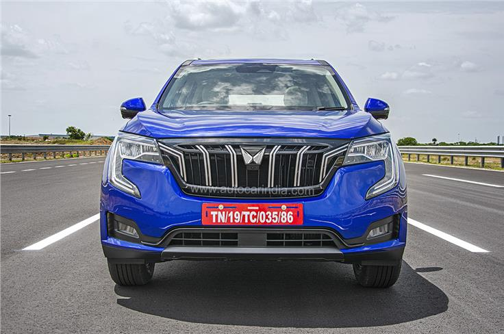 Large, chrome-embellished front grille houses the new Mahindra SUV logo.