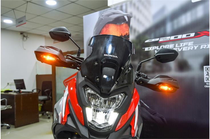 Changes up front include the addition of a semi-fairing, tinted windscreen and handguards.