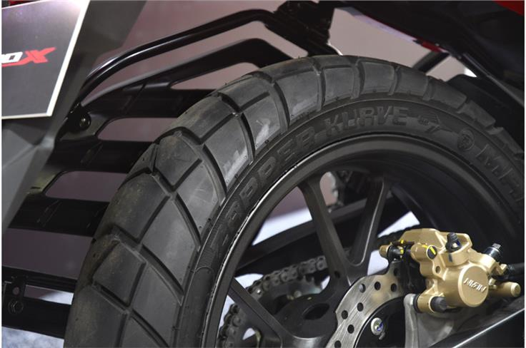 Block-pattern tyres add a touch of off-road ability, but there is no additional suspension travel on offer.