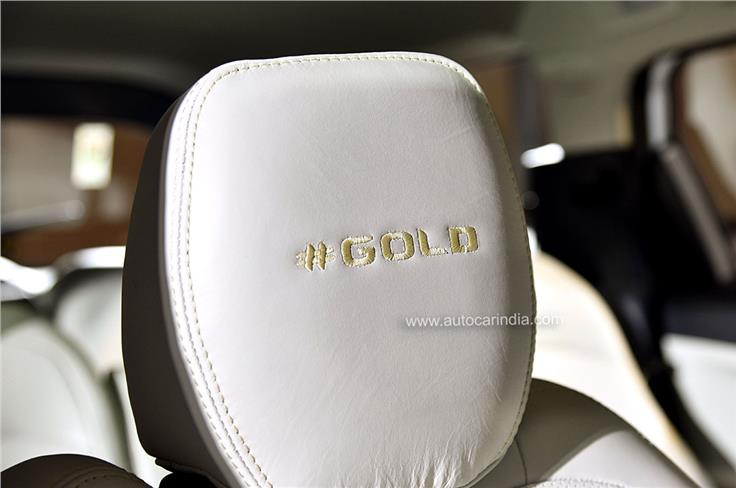 Seats feature '#Gold' stitched into the headrests.